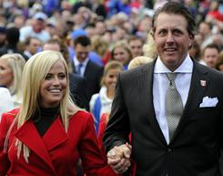 US Ryder Cupper Phil Mickelson, right, and wife Am after the Opening Ceremony of the 2010 event in Newport, Wales in September.