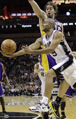 The Spurs' Tony Parker drives past the Lakers' Pau Gasol during the first quarter on Tuesday. Parker finished with 23 points and San Antonio beat Los Angeles 97-82.