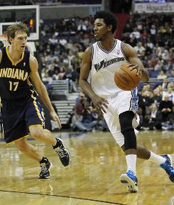 Washington Wizards shooting guard Nick Young dribbles the ball as Indiana Pacers small forward Mike Dunleavy defends. The Wizards won 104-90.
