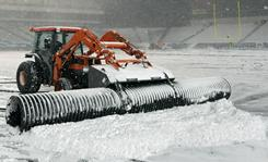 A plow removes snow from the playing surface at Lincoln Financial Field on Sunday, the day the game between the Philadelphia Eagles and Minnesota Vikings was supposed to be played. The game was moved to Tuesday night.