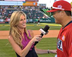 Erin Andrews has friendly words with USA catcher Hank Conger after the 2010 Futures Game during All-Star festivities.