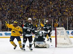 A Michigan State-Michigan outdoor game at Michigan Stadium drew 113,411 fans, a world record for hockey attendance. The stadium could be an ideal future site for a Winter Classic.