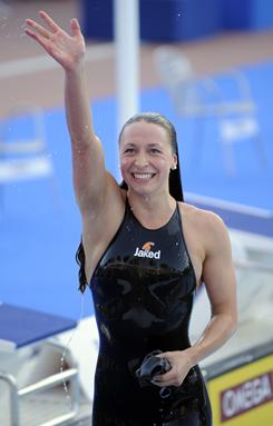 Ariana Kukors, celebrating after winning the gold medal and setting a world record in the 200-meter individual medley at the 2009 Swimming World Championships in Rome, was trained by coach Sean Hutchison at the Fullerton Aquatics Sports Team.