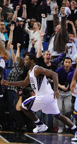 Sacramento Kings point guard Tyreke Evans celebrates after making the game-winning shot against the Memphis Grizzlies as tme expired. The Kings defeated the Grizzlies 100-98.