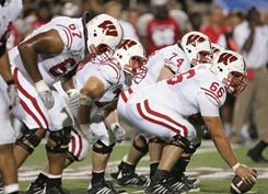 The Wisconsin offensive line will hope to open holes for its running game against TCU in the Rose Bowl.