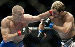 Georges St-Pierre, left, dominated Josh Koscheck during his title defense in December but Koscheck didn't suffer a drop in the welterweight rankings.