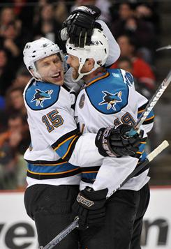 Sharks right wing Dany Heatley, left, congratulates center Joe Thornton after Thorton scored the tiebreaking goal in the third period of San Jose's 5-3 win.