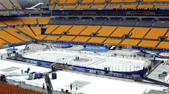 Crews at Heinz Field prepare the ice surface on Thursday as work continues for Saturday's Winter Classic NHL game between the Washington Capitals and the Pittsburgh Penguins.