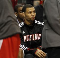 Portland Trail Blazers guard Brandon Roy sits on the bench before their  game against the Utah Jazz on Thursday.  Roy has been sidelined indefinitely with sore knees.