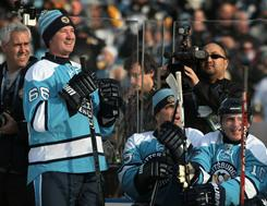 Mario Lemieux watches from the bench during the 2011 NHL Winter Classic Alumni Game against the Washington Capitals on Friday at Heinz Field in Pittsburgh.
