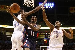 Atlanta Hawks guard Jamal Crawford is fouled by Oklahoma City Thunder forward Kevin Durant as he goes up for a shot in the fourth quarter on Friday.  Crawford had 26 points for Atlanta, but Oklahoma City won 103-94.