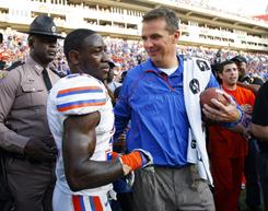 Florida coach Urban Meyer celebrates with with safety Ahmad Black (35) after the Gators beat Penn State in the Outback Bowl.