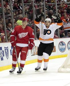 Philadelphia's Danny Briere, right, celebrates Scott Hartnell's goal against the Detroit Red Wings during the second period of their game Sunday in Detroit.