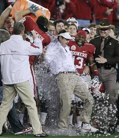 Oklahoma Sooners head coach Bob Stoops gets dunked after beating the University of Connecticut at the Fiesta Bowl in Glendale, Ariz.