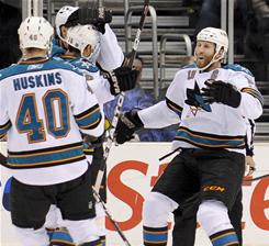 The Sharks celebrate Devin Setoguchi's goal in their 1-0 win over the Kings.