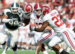 Alabama quarterback Greg McElroy hands off to running back Mark Ingram (22) against Michigan State in one of the SEC victories over the Big Ten.