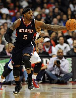 Clippers guard Eric Gordon follows as Hawks forward Josh Smith takes it down court on Sunday. Smith finished with 22 points as Atlanta defeated Los Angeles 107-98.