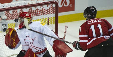 Casey Cizikas scores against Swiss goalie Benjamin Conz during Canada's 4-1 victory Sunday at the world junior championships.