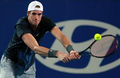John Isner of the USA lines up a backhand during his victory against Nicolas Mahut of France at the Hopman Cup on Monday in Perth, Australia. The match lasted 90 minutes, quite a bit shorter than their epic match at Wimbledon last summer that ended 70-68 in the fifth set.