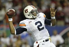 Heisman Trophy winner Cam Newton compiled 2,589 yards passing and 1,409 rushing for the second-ranked Auburn Tigers.
