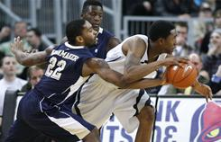 Pittsburgh guard Brad Wanamaker, left, strips the ball from Providence guard Marshon Brooks during the second half. Brooks led all scorers with 28 points.