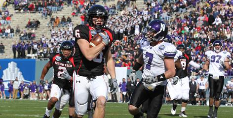 Texas Tech receiver Austin Zouzalik scores a touchdown against Northwestern Jan. 1 at the TicketCity Bowl, one of two new bowl games in 2010-11.