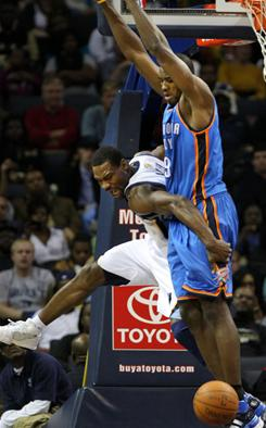 Memphis Grizzlies guard Tony Allen, left, collides with Oklahoma City Thunder forward Serge Ibaka during the Grizzlies' 110-105 win. The team acknowledged that Allen was later involved in an altercation on the team's flight home.