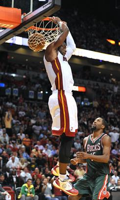 Miami guard Dwyane Wade dunks the ball during the Heat's 101-89 win over the Milwaukee Bucks at American Airlines Arena.