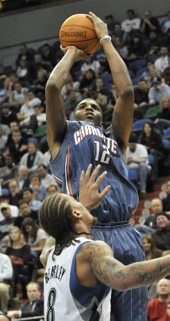 The Bobcats'  Tyrus Thomas shoots over the Timberwolves' Michael Beasley in the second half on Wednesday. Thomas scored 21 points in the Bobcats' 108-105 overtime win.