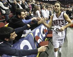 New Jersey fans congratulate Sasha Vujacic after he scored a basket with 5.3 seconds to play to break a tie and give the Nets a 96-94 victory over the Chicago Bulls on Wednesday.