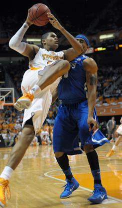 Tennessee forward Tobias Harris, power to the basket against Memphis forward Will Coleman, recorded a double-double to spark the Volunteers' 104-84 rout.