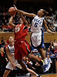 Duke guard Jasmine Thomas, elevating to block the shot of Maryland forward Alyssa Thomas, scored 22 points to help the Blue Devils improve to 15-0.