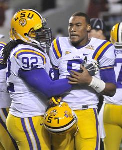 LSU quarterback Jordan Jefferson, right, is consoled by defensive tackle Drake Nevis after Jefferson fumbled late in the fourth quarter of a loss to Arkansas on Nov. 27. LSU's offense has completed just seven touchdown passes in 2010.