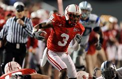 Miami (Ohio) defensive back Dayonne Nunley runs down the sidelines during a 53-yard interception return for touchdown in the second half. Nunley also recovered a fumble.