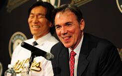 Billy Beane, right, was happy to sign Hideki Matsui to help an Athletics lineup that was near the bottom of the AL East in runs, home runs and slugging.