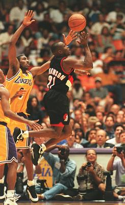 Rumeal Robinson, playing for the Portland Trail Blazers in 1997 against Eddie Jones, left, and the Los Angeles Lakers, will spend the next 5-plus years in prison.