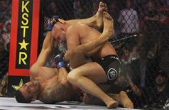 Fabricio Werdum, bottom, submitted Fedor Emelianenko with a triangle choke-armbar on June 26. The loss knocked Emelianenko out of the consensus No. 1 ranking after years of domination.