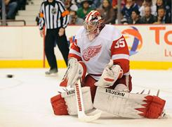 Jimmy Howard stopped 34 shots and all three of the Canucks' shootout attempts to lead the Red Wings to a win.