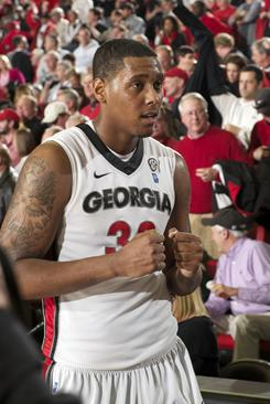 Georgia Bulldogs forward Trey Thompkins pumps his fists in celebration after his team defeated the Kentucky Wildcats 77-70.