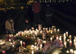A group of people attend a candlelight vigil outside University Medical Center in Tucson for Rep. Gabrielle Giffords and other victims of the recent shooting.