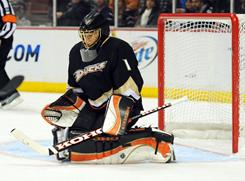 Anaheim Ducks goalie Jonas Hiller blocks a shot against the San Jose Sharks at the Honda Center. Hiller saved 37 shots in the Ducks' 1-0 victory.