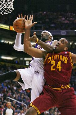 Phoenix' Hakim Warrick shoots as Cleveland's Samardo Samuels defends on Sunday.  The Suns beat the Cavaliers 108-100.