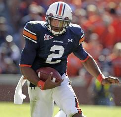 Auburn quarterback Cam Newton will try to follow his Heisman Trophy win with a victory in the national title game.