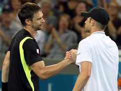 Robin Soderling of Sweden, left, shakes hands with Andy Roddick after topping the American in the final of the Brisbane International on Sunday in Brisbane, Australia.
