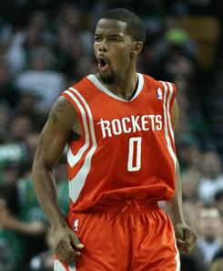 Aaron Brooks hit a pair of key free throws late to help the Rockets win in Boston and snap a five-game losing streak.
