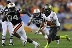 Oregon running back LaMichael James carries the ball, eluding Auburn defensive end Nosa Eguae during the third quarter.