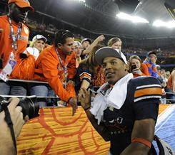 Auburn quarterback Cameron Newton (2) enjoys a victory lap around University of Phoenix Stadium after leading the Tigers to the 2011 national championship Monday night.