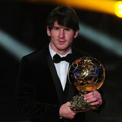 Lionel Messi poses with the FIFA Ballon d'Or award in Zurich.