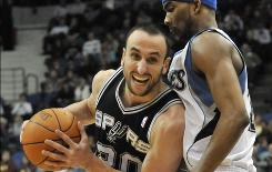San Antonio's Manu Ginobili drives around Minnesota's Corey Brewer during the second half on Tuesday. Ginobili led the Spurs with 19 points in their 107-96 win over the Timberwolves.
