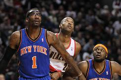 New York power forward Amare Stoudemire and Portland power forward Marcus Camby look for the rebound on Tuesday. Stoudemire finished with 23 points as the Knicks beat the Trail Blazers 100-86.